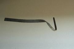 """""""Zeichen"""" Abb. 5, Holz in der Flamme gebogen, Maße ca. 180 × 20 × 5 cm³, 2006"""